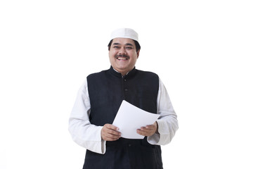 Smiling politician holding a document