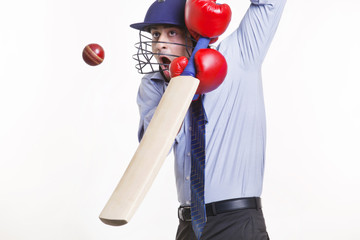 Batsman hitting ball over white background