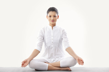 Woman doing yoga over white background