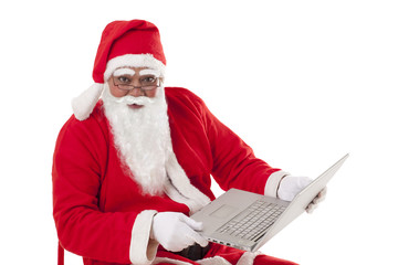 Portrait of Santa Claus holding laptop over white background