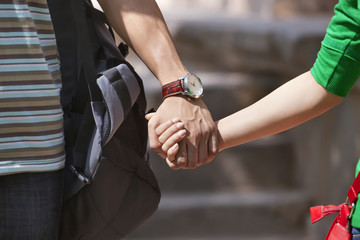 Couple holding hands in a park