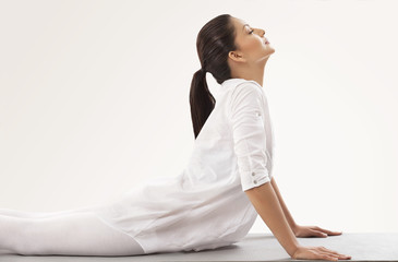 Young woman in upward facing dog position