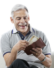 Old man taking out money from his wallet