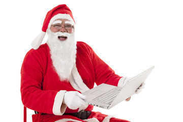 Happy Santa Claus using laptop over white background