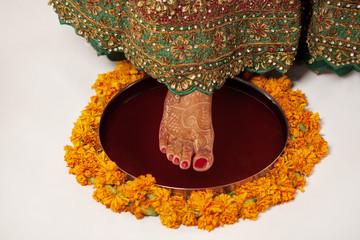 Close-up of brides foot on a thali