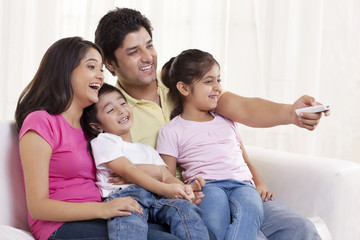Cheerful family watching TV