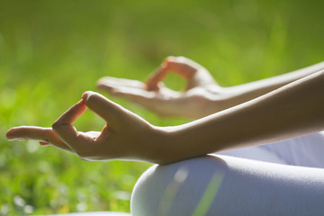 Close-up of woman's hands in yoga gesture