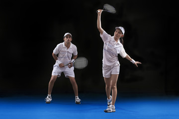 Players playing tennis doubles at court