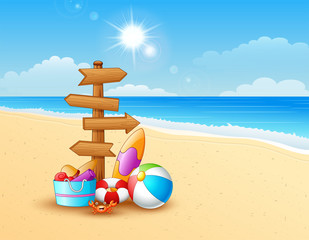 Summer beach with wooden arrow