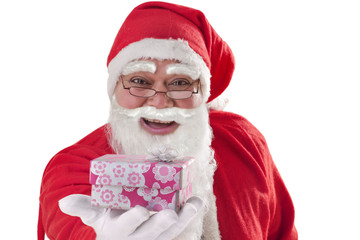 Close up of Santa Claus giving present over white background