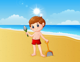 Boy playing a sand with shovel