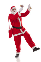 Full length of Santa Claus dancing with chocolate over white background