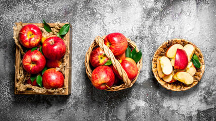 Red apples in the box and baskets.