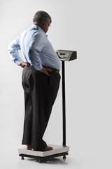 Obese man checking his weight