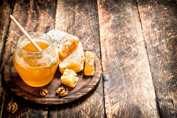 Wall Mural - The honey in the jar with the nuts .