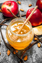 Wall Mural - Honey background. Honey with apples and nuts.