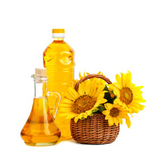 Beautiful flowers of sunflowers in a rustic basket and sunflower oil on a white background.