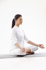 Smiling young woman in lotus position