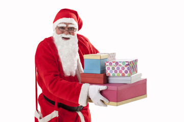 Portrait of smiling Santa Claus carrying Christmas present
