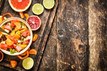 Summer food . Fruit salad in a bowl.