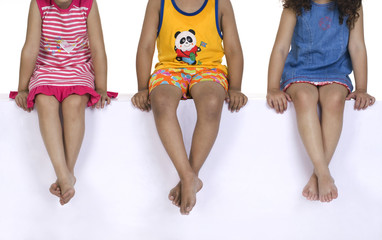 Children sitting with their legs crossed