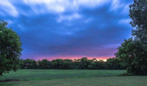 Purple Sunset Sky Over Farm Field