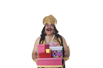 Man dressed as Raavan holding gifts and laughing