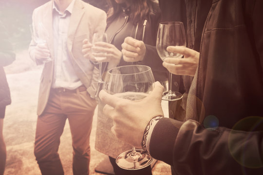 people is drinking wine vintage effect, a group of friends is socializing and having a fun