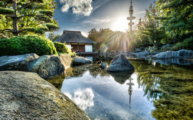 Japanese garden in the city at sunset
