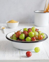 Fresh gooseberries in enameled bowl
