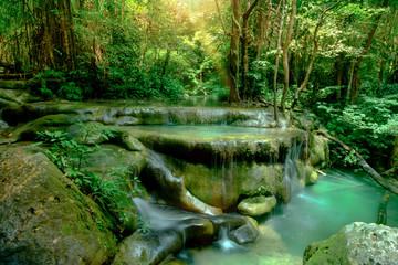 Amazing beautiful deep forest waterfall in Erawan National Park, Kanchanaburi, Thailand