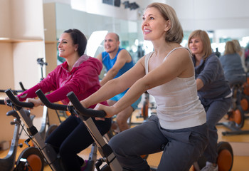 females on exercise bikes in the gym