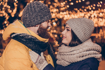 Close up cropped side profile photo of beautiful young couple embracing outdoors at winter on a new year`s eve, so tender, romantic, tempting, sensual. True love and feelings