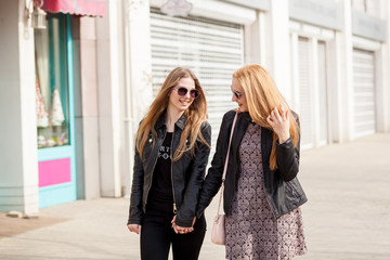 Two hipster girl friends hanging out in the city. Youth and friendship
