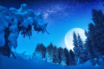 Wonderful rising of full moon in a winter valley