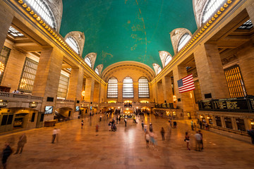 Inside view of the main hall of Grand Central Terminal Station with many peoples in motion. Picture of the big main concourse of the historic railroad station.