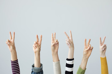 Hands showing victory sign