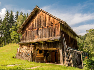 Old wooden village barn in the hills