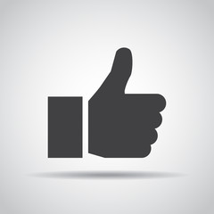 Thumb up icon with shadow on a gray background. Vector illustration