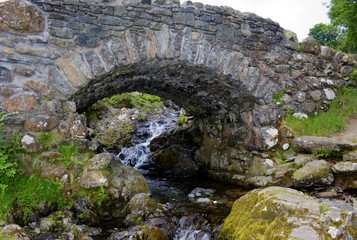 Stone Bridge Over Stream