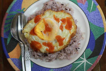The eggs are on the rice.