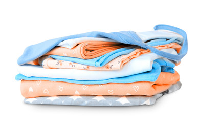 Stack pile folded cotton clothes on white.