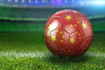 China Soccer Ball on Stadium Green Grasses at Night