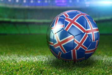 Iceland Soccer Ball on Stadium Green Grasses at Night