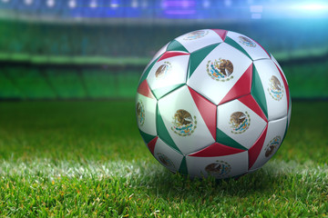 Mexico Soccer Ball on Stadium Green Grasses at Night