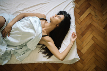 Young woman laying in bed