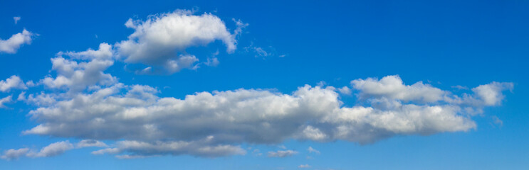 Blue sunny sky with white clouds landscape banner, huge panorama