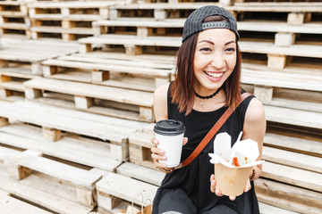 happy female customer with takeaway coffee cup and paper box with asian wok noodles