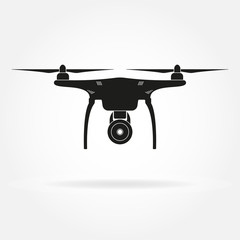 Drone icon. Copter or quadcopter with camera black silhouette. Vector illustration.