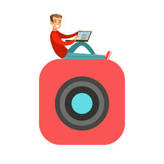 Young smiling man sitting on a big mobile app symbol and using his laptop colorful character vector Illustration